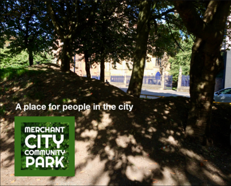 "Photograph of a region of the proposed site of Merchant City Community Park on Ingram St, Glasgow, with the Merchant City Community park logo and the streamline ""A place for people in the city"""